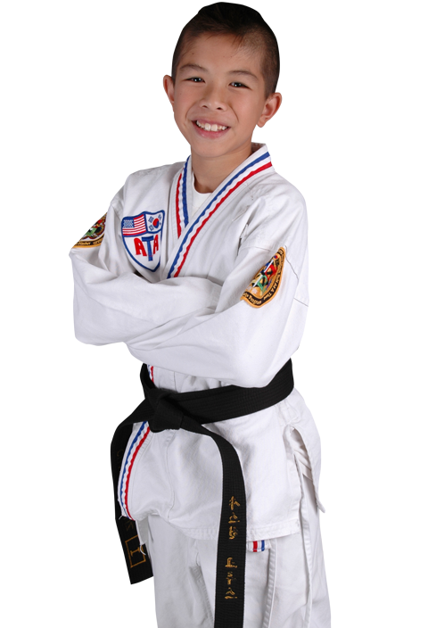 boy in karate gi with arms crossed